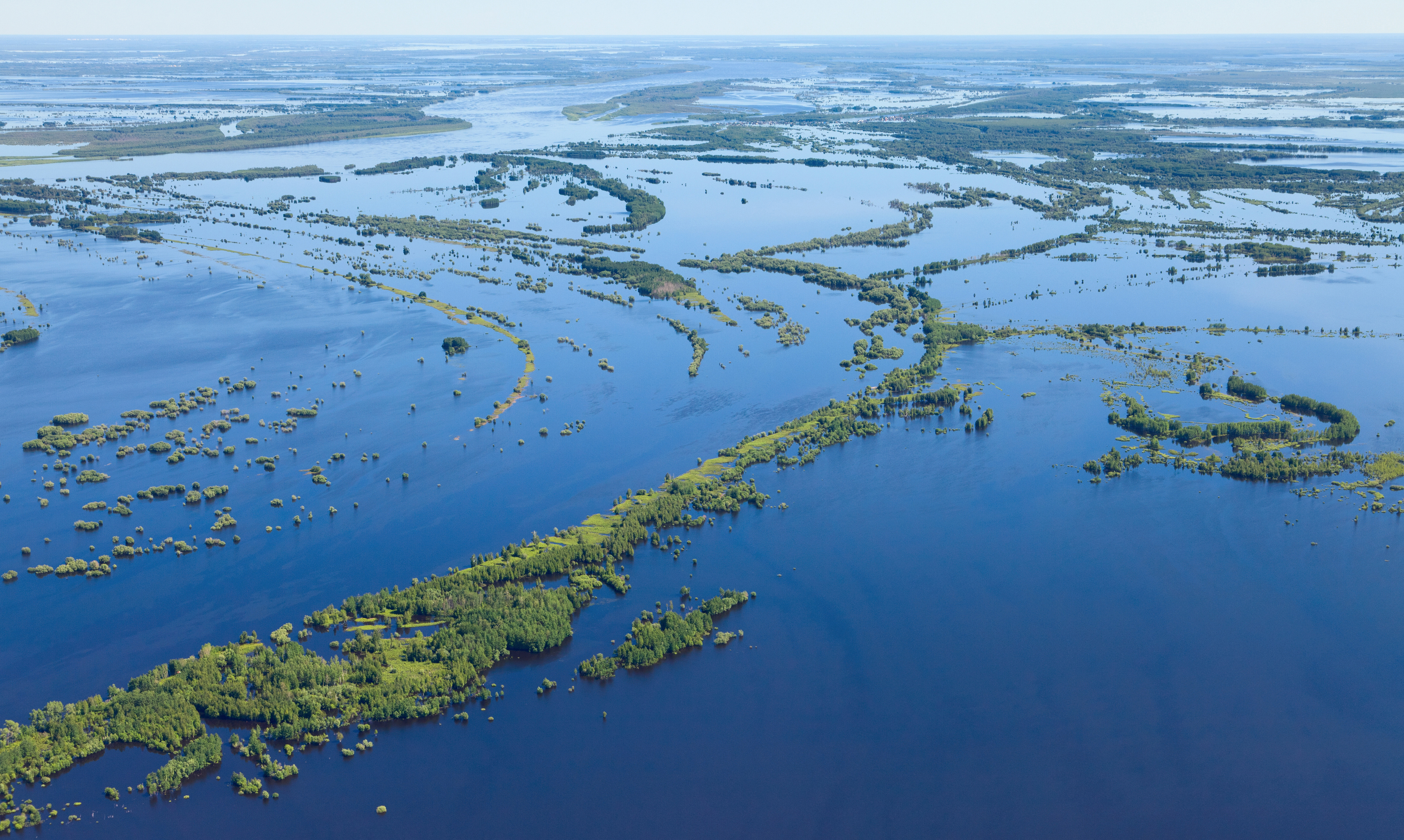 Flooding of bottom land of the Big Siberian river Ob in spring period, top view
