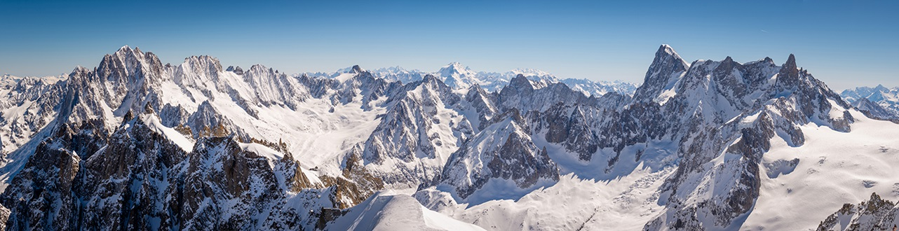 Panorama of snow capped peaks and glaciers in the French alps