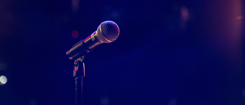 Microphone on stand with dark background