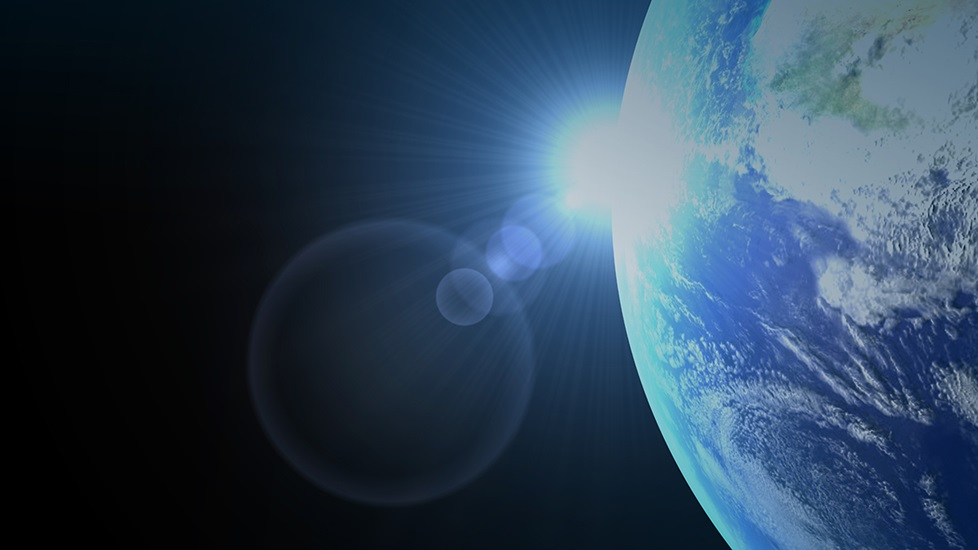 Artist's rendering of Earth in space with rising sun