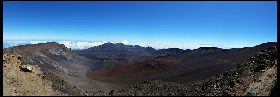 view over a volcanic crater with blue sky