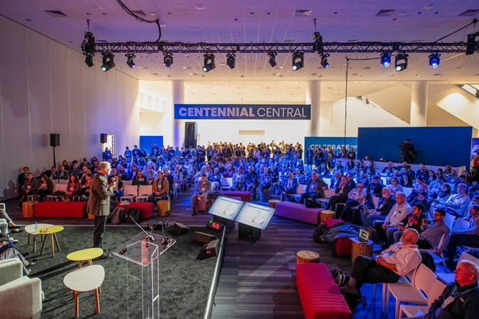 A crowd view of a Fall Meeting 2019 speaker in the Centennial Central area (Moscone Center, San Francisco)