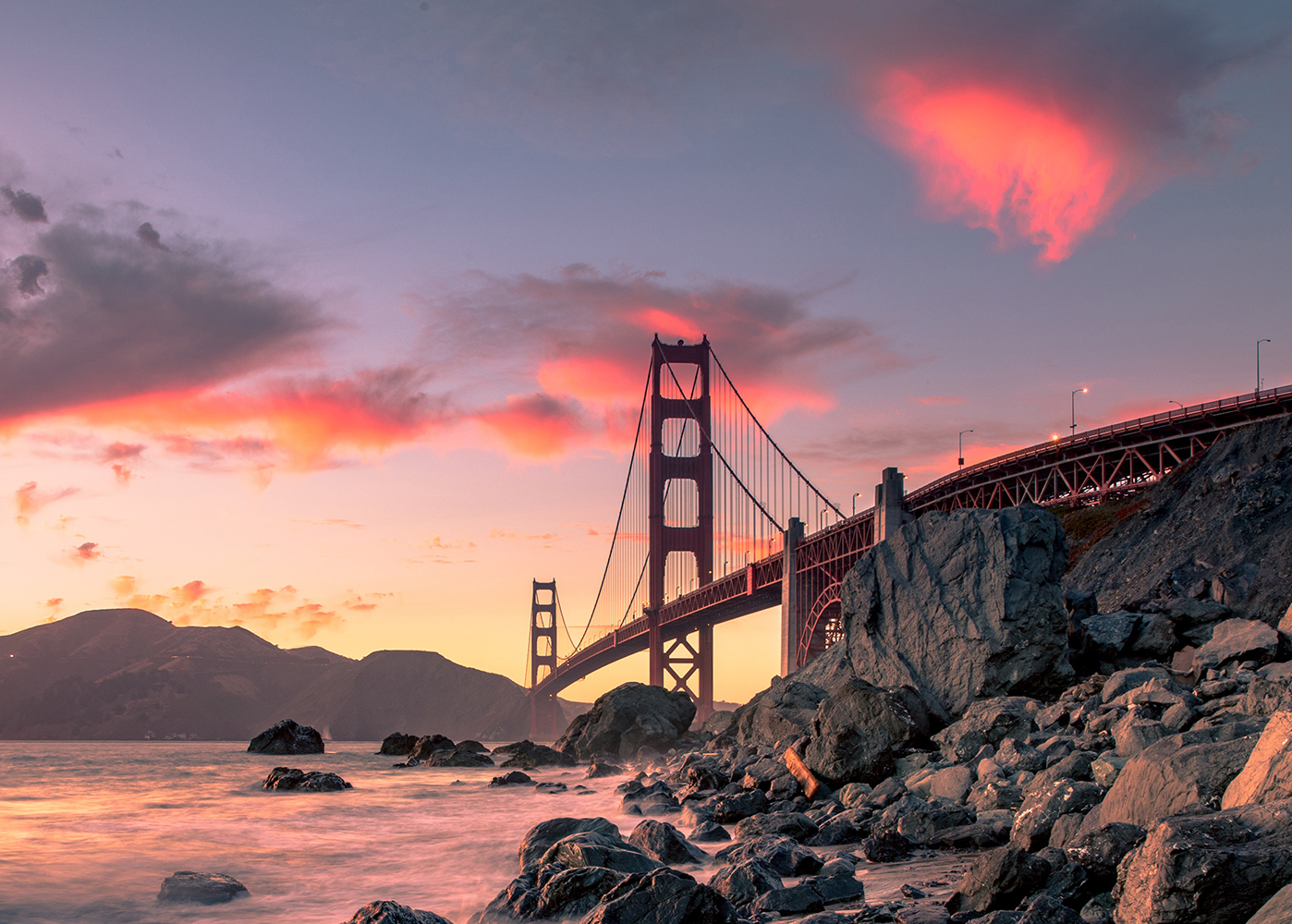 View of Golden Gate bridge from rocky shoreline
