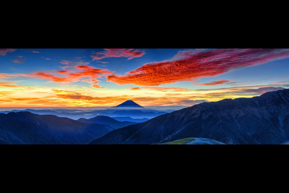 Mountains with colorful clouds and sky at dawn