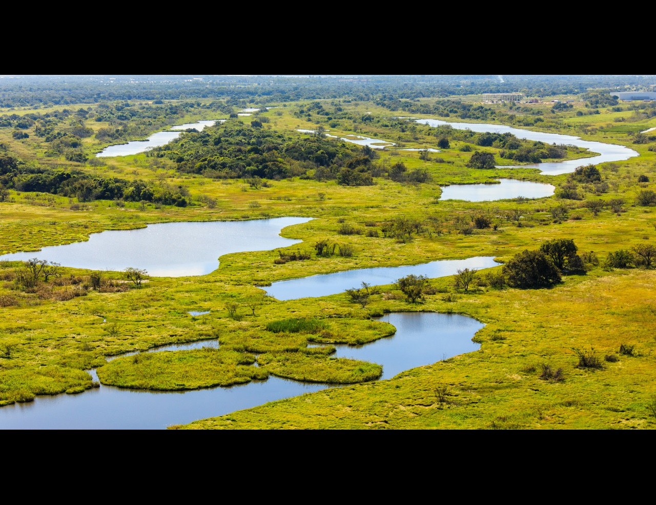 Veiw from helicopter of wetlands and ponds around the Paraguay River