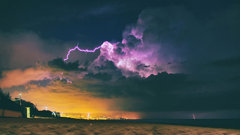 Clouds with bold of purple lightning