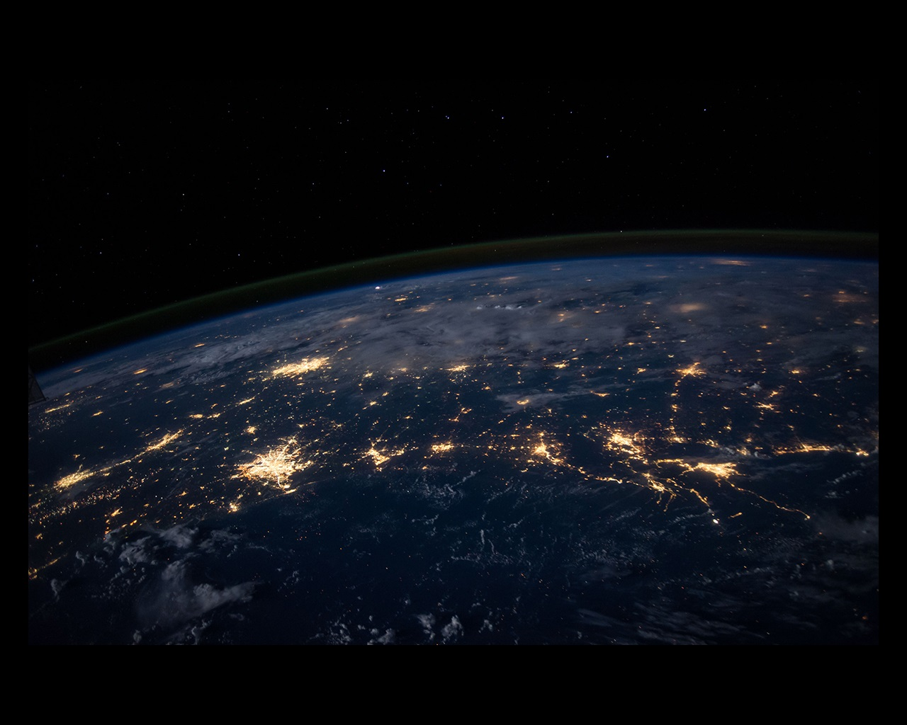 Night view of Earth from above with city lights
