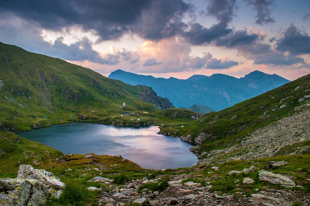 Lake on side of mountain in Romania