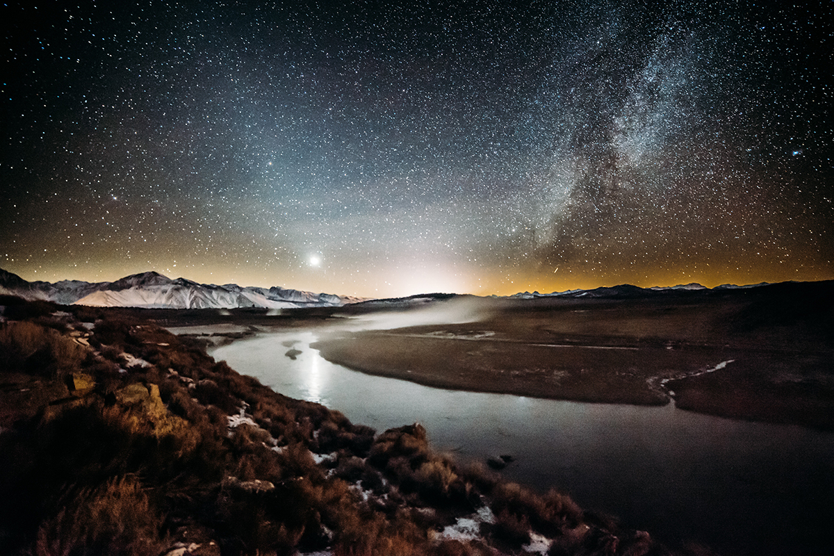 Night view of river and mountains with starry night sky