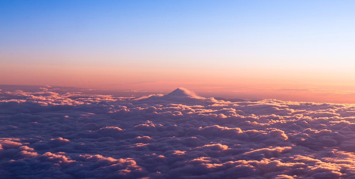 Sunrise over bed of clouds