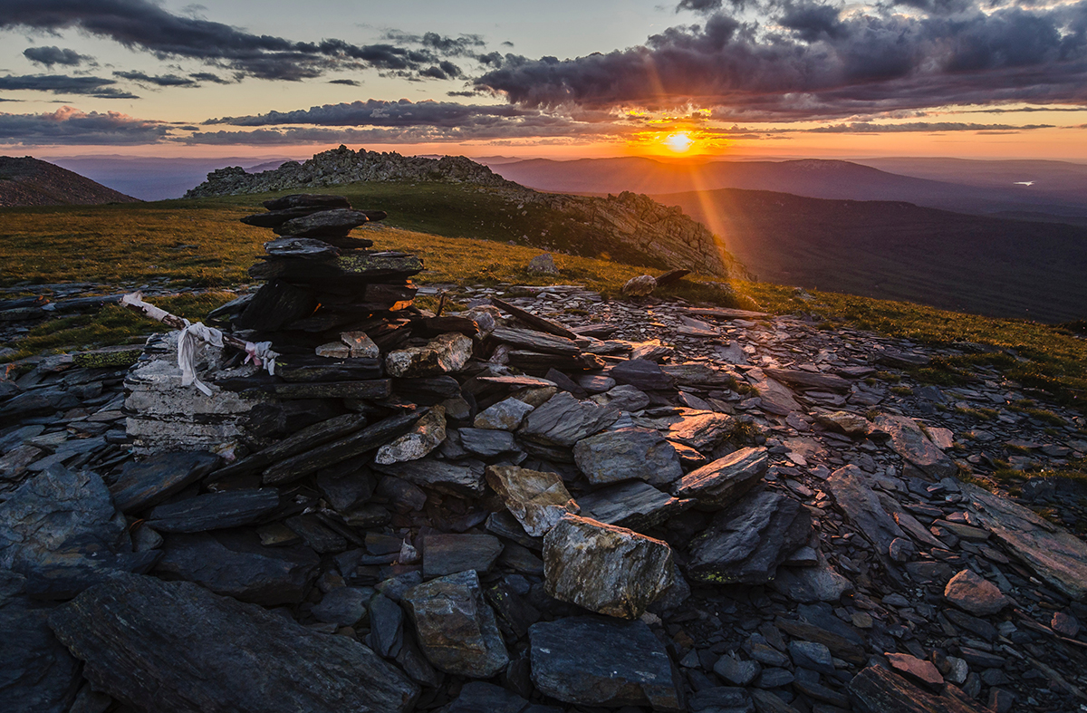 Sunrise over a bed of rocks on side of mountain in Russia