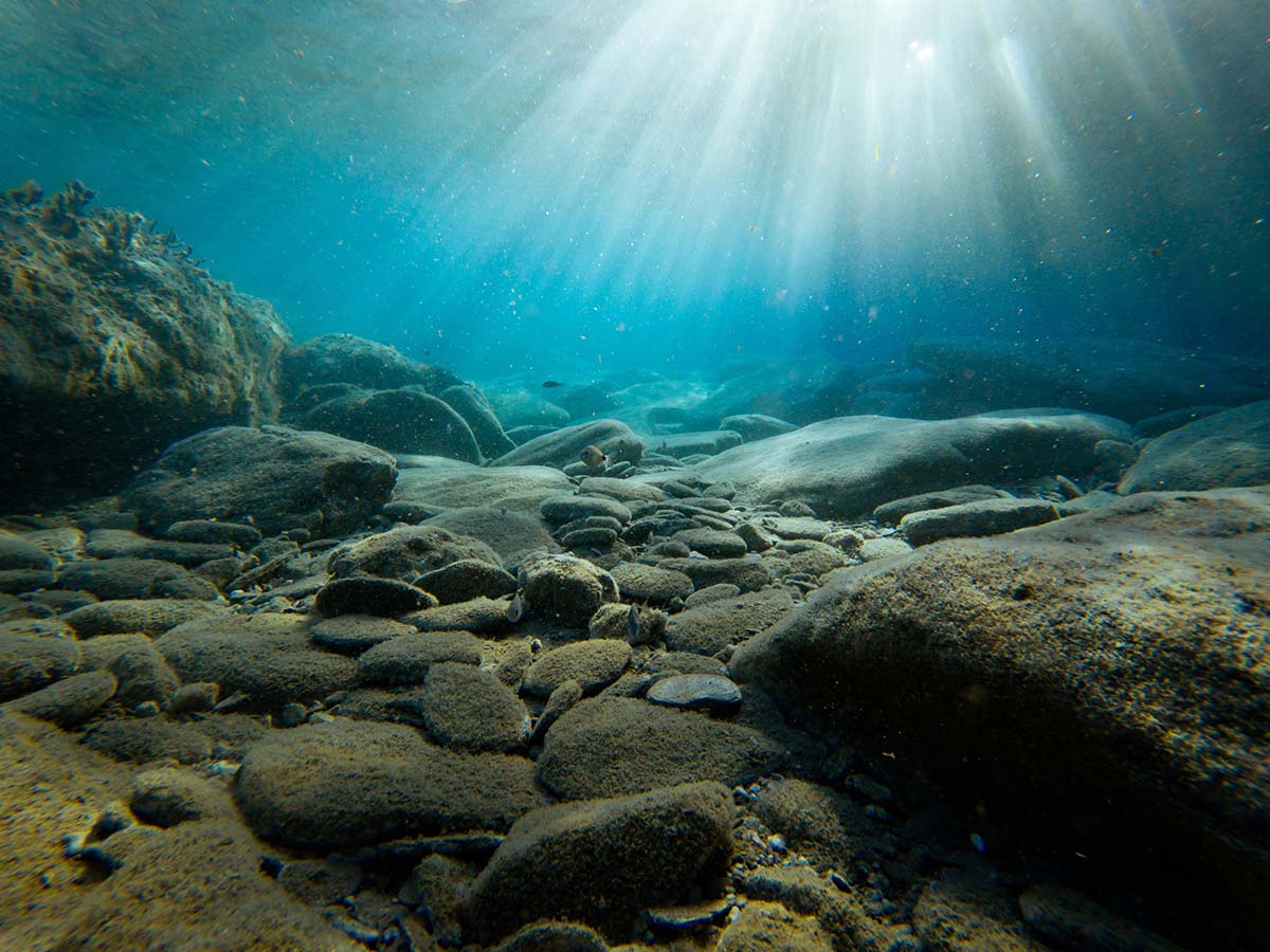 Underwater view of rocks with sunlight, Greece
