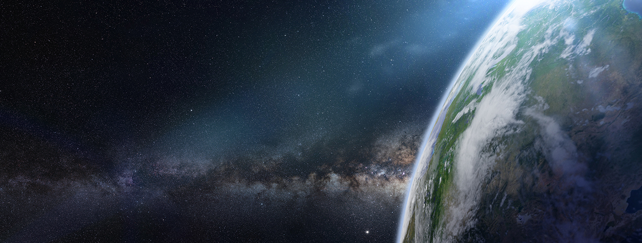 Side view of Earth with stars and galaxy