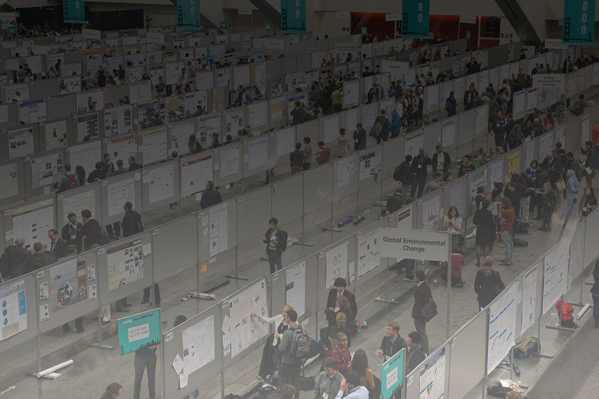 A photo of the poster hall at AGU Fall Meeting with a gradient overlay
