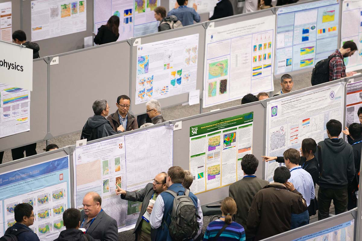 several poster presenters in poster hall