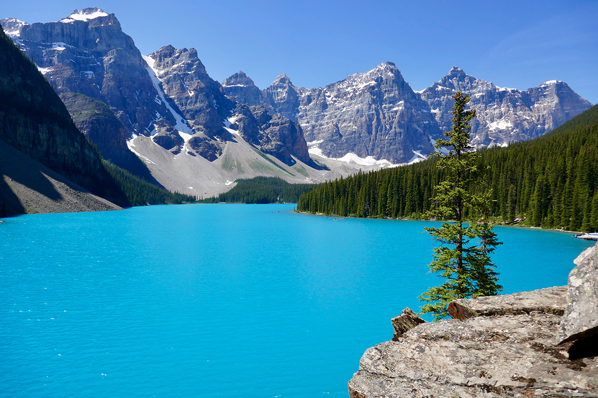 Teal lake with mountains in background, Canada