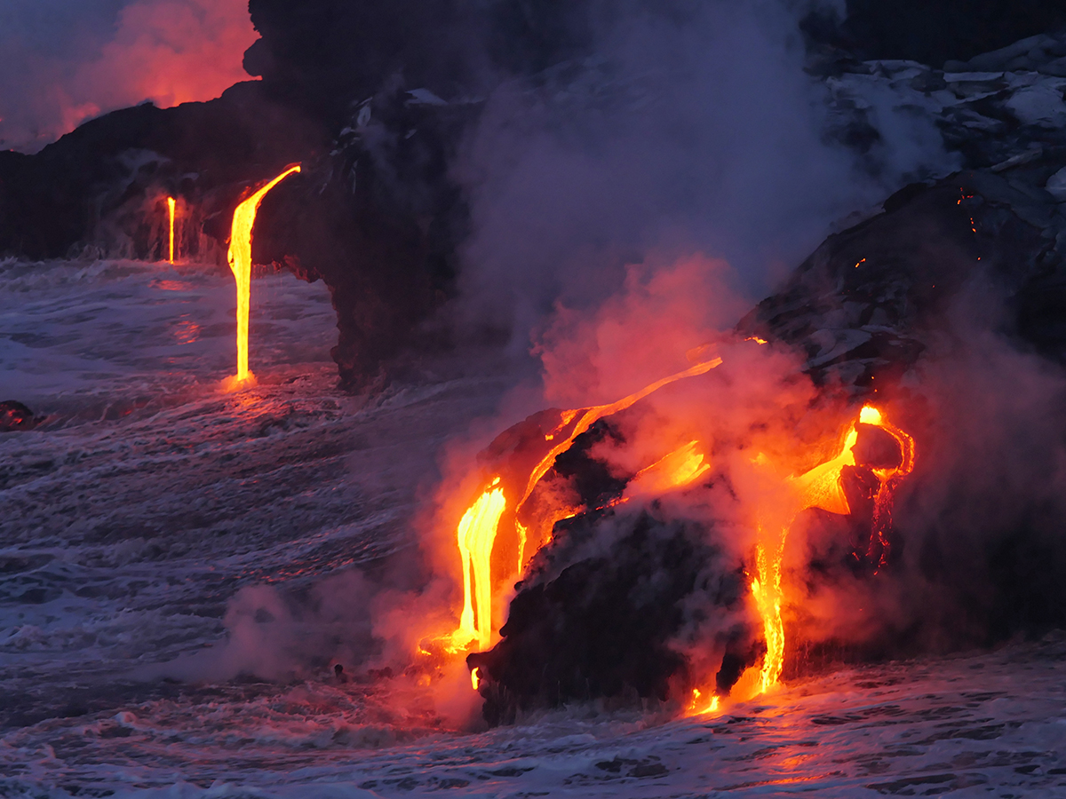 Multiple lava flows falling into the ocean in Hawaii