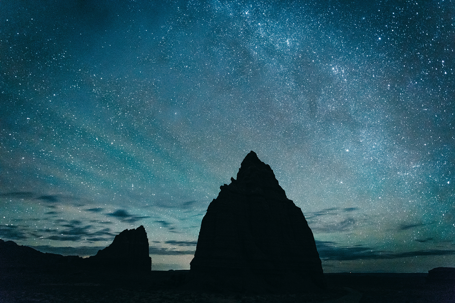 Rock formations silhouetted against a starry night