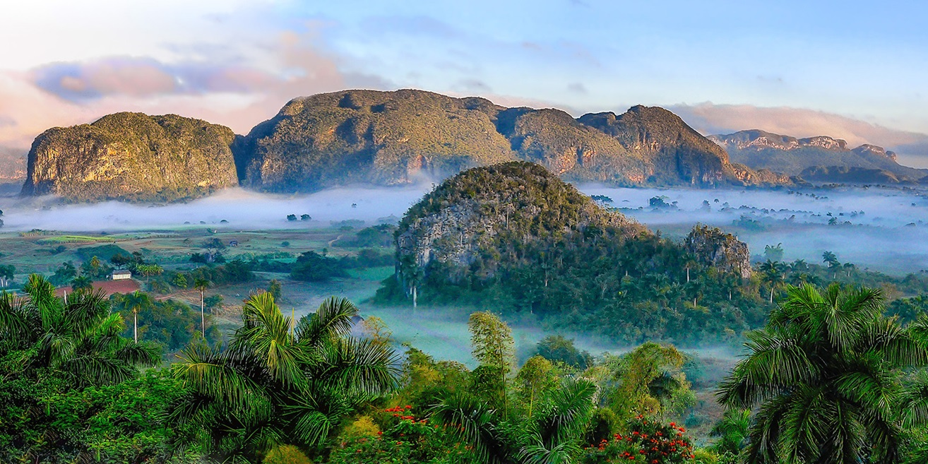 Hills above rainforest and mist in Cuba