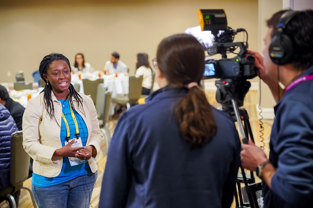A woman is interviewed by video
