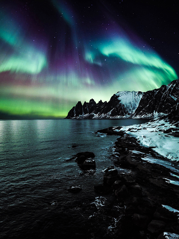 Aurora borealis over the lake in the evening
