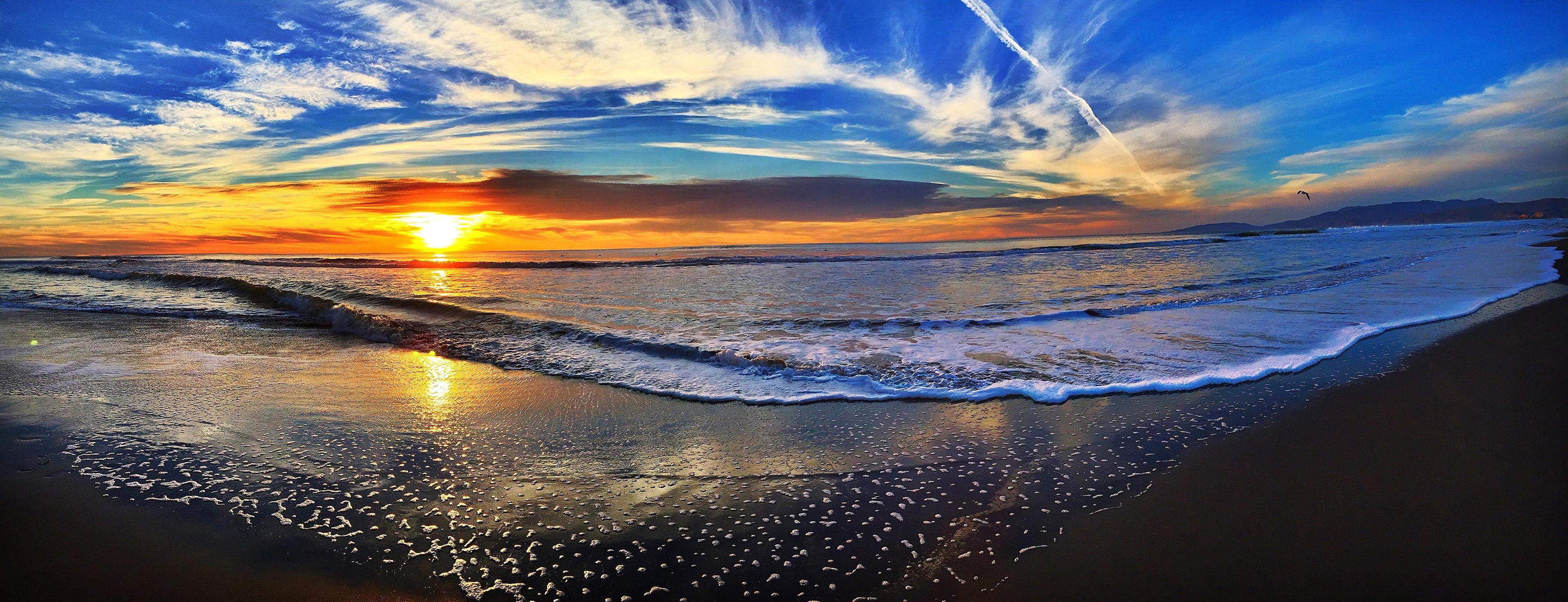Panoramic beach at sunset