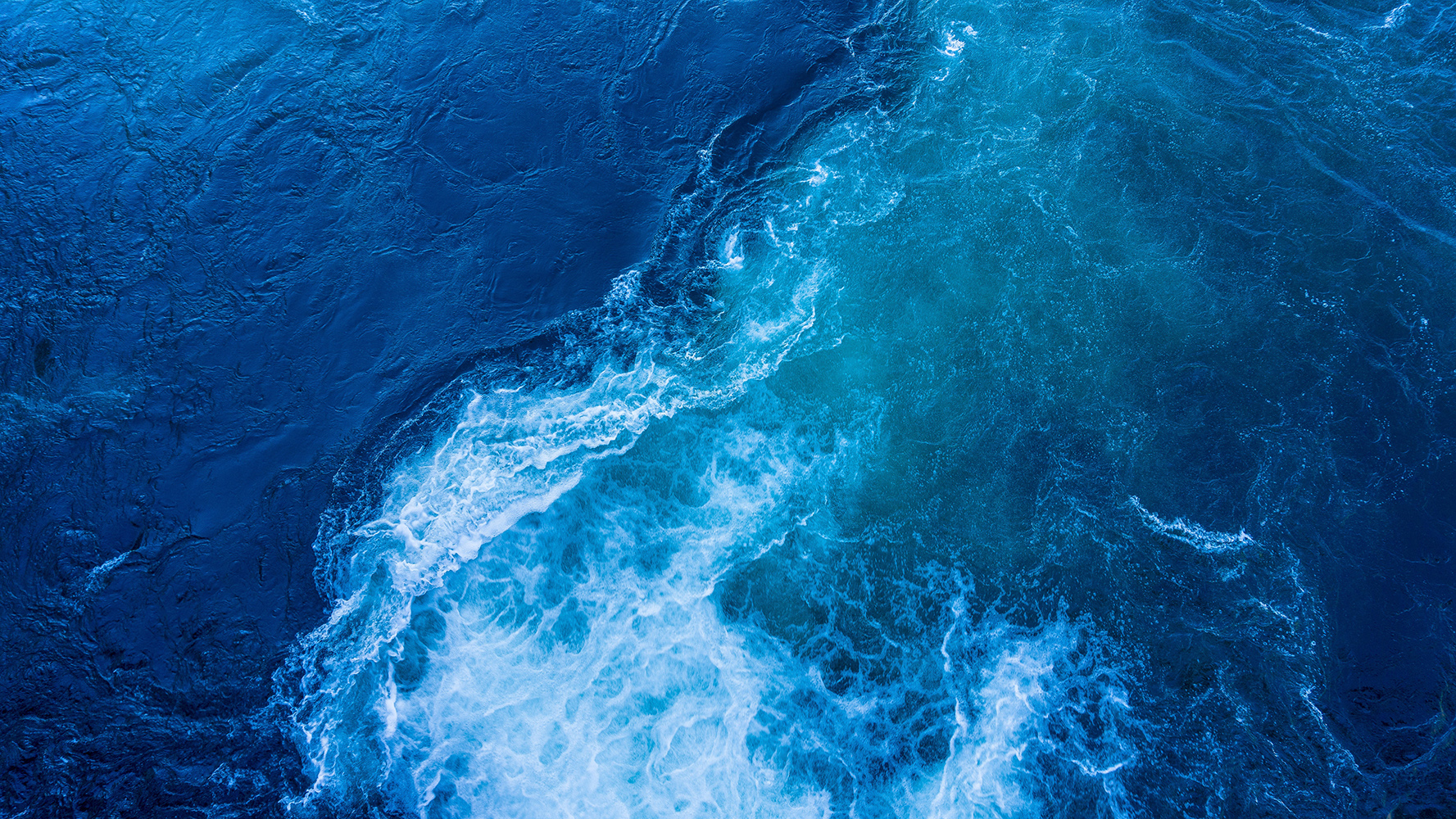 Blue ocean tide with foam