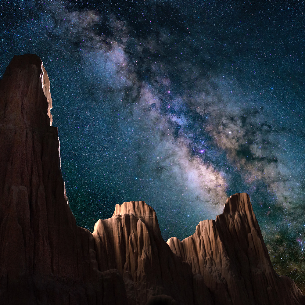 Rock formation shining under a galaxy of stars