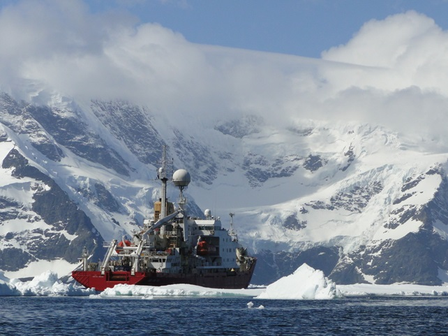 RRS James Clark Ross dodging icebergs in the southern Ocean in Antarctica