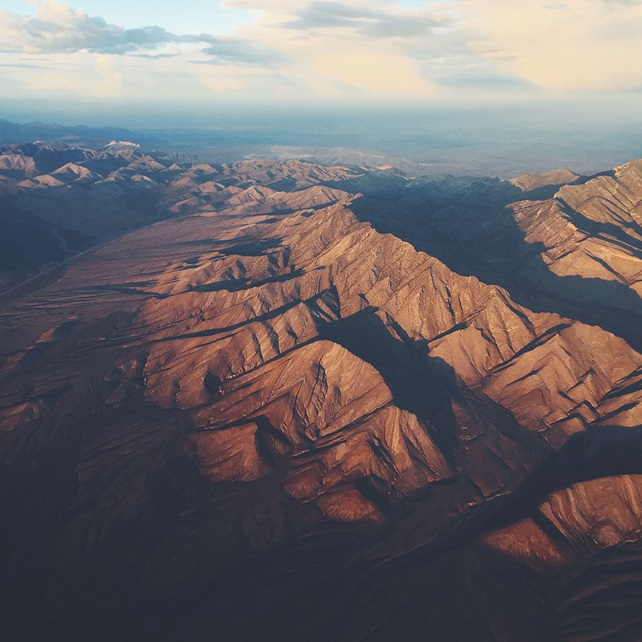 view from a plane of an arid mountain scape