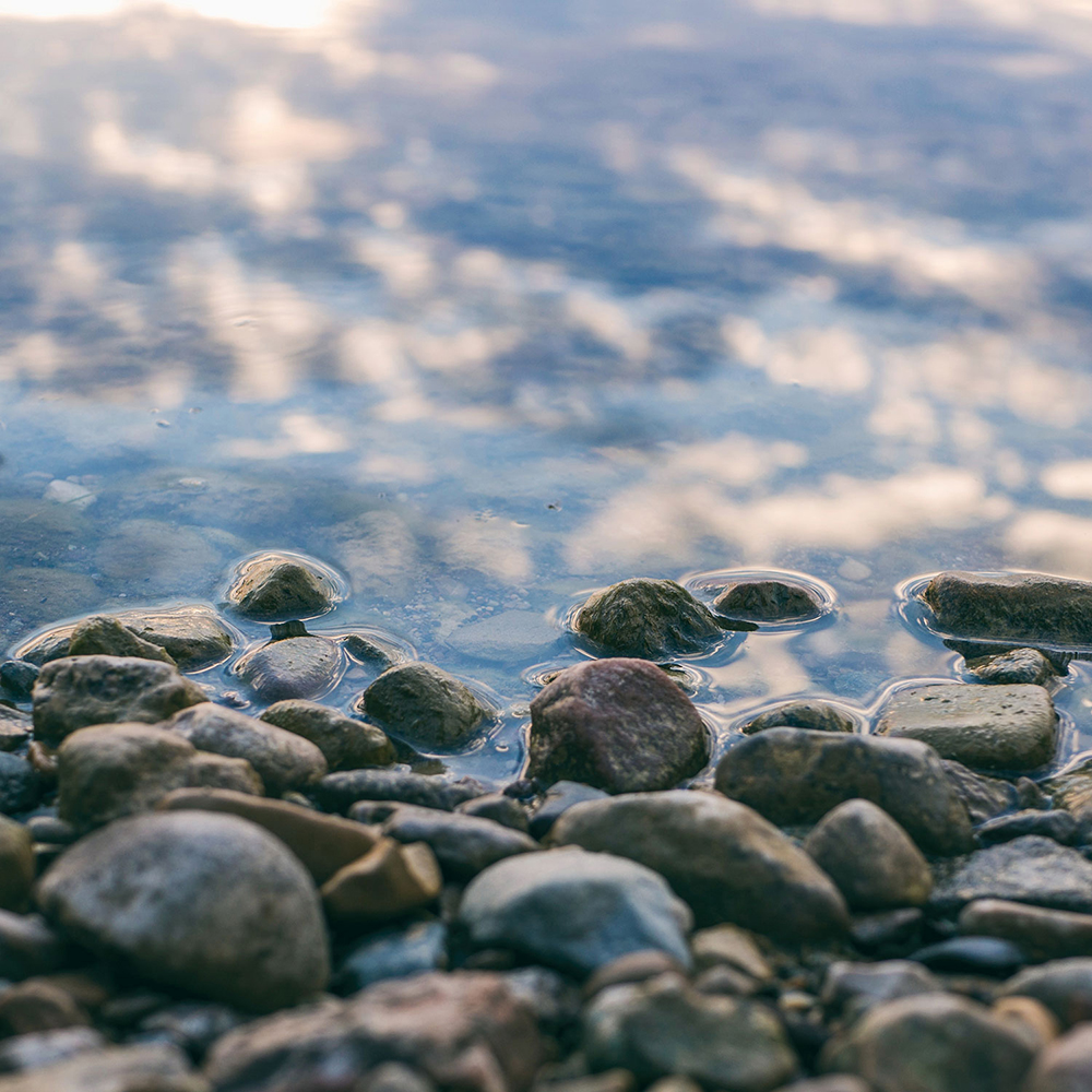 Pebble rocks piled up on the shore