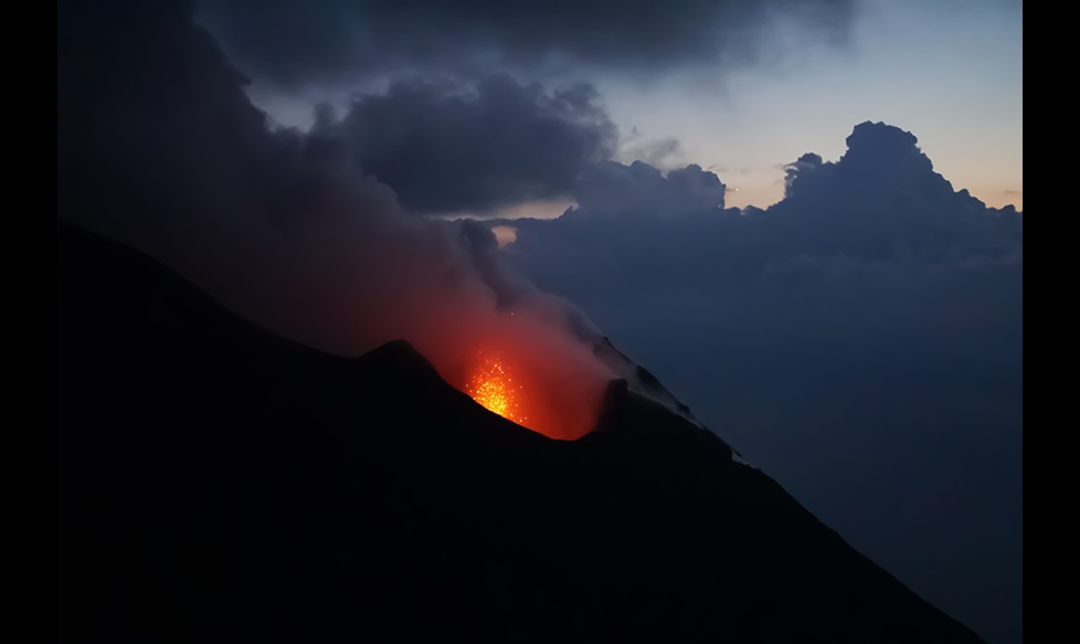 Night view of lava from volcano