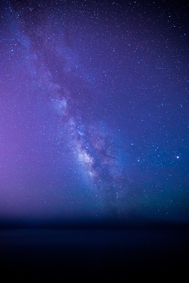 Purple gradient of night sky with stars