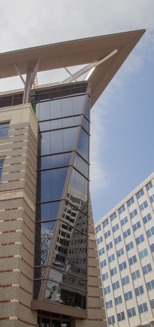 A photo looking up at the building's glass Prow