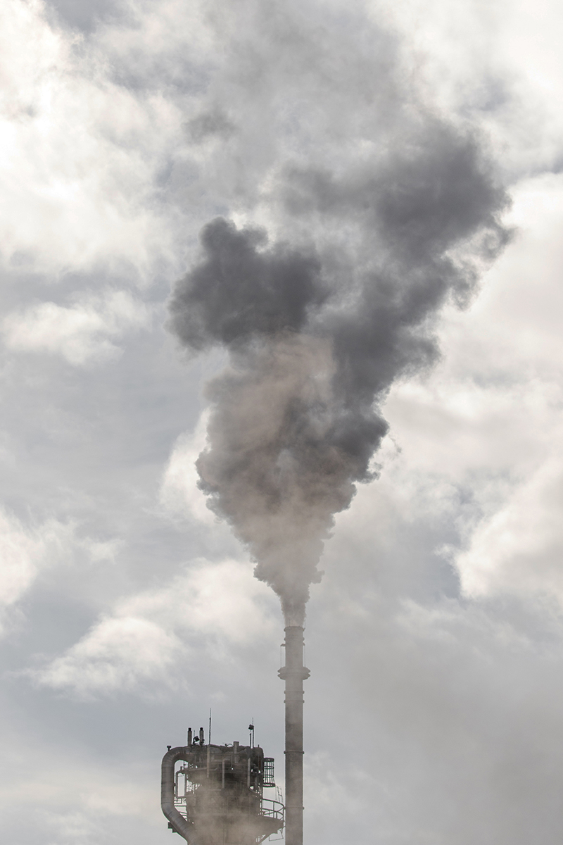 Vertical image of air pollution on cloudy day