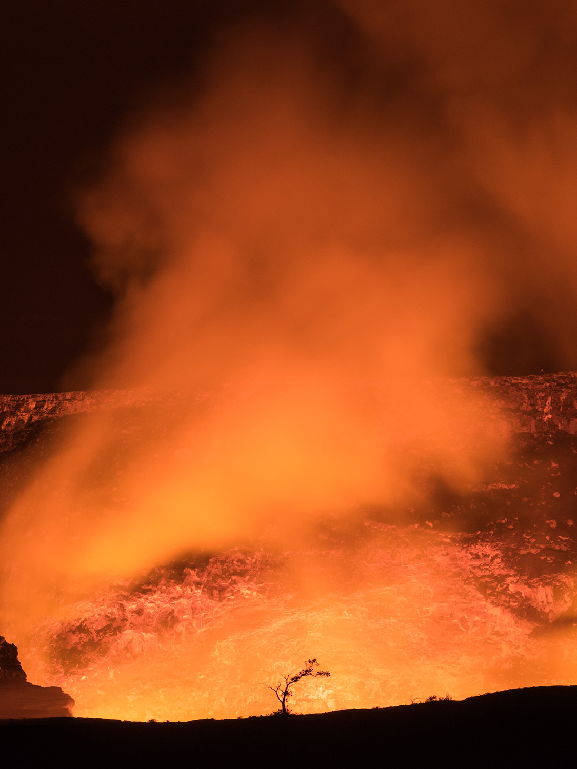 Night view of lava at Kilauea's crater, USA