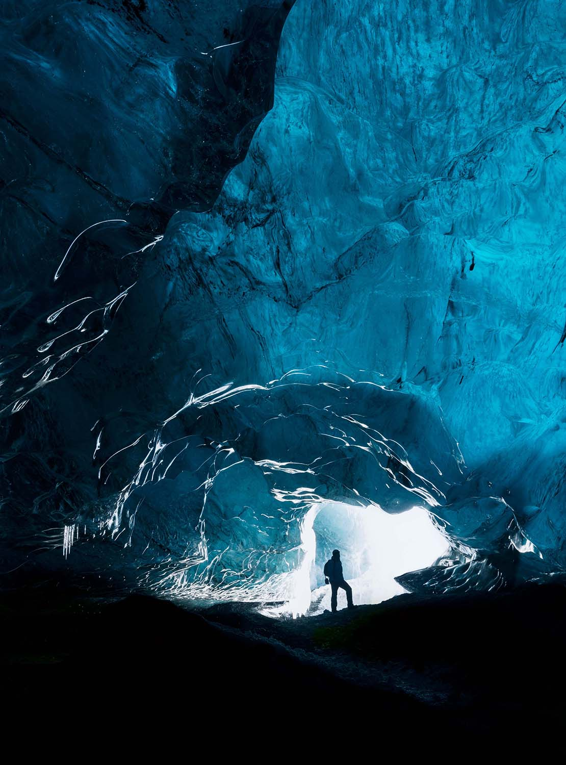 Person exploring a glacial cave in Iceland