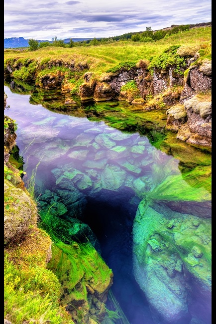 Water in a fissure between tectonic plates in Iceland